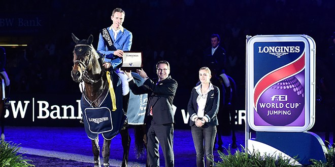 Winner Christian Ahlmann (GER) riding Codex One,Presenting is Rainer Eckert Longines Brandmanager. Pic